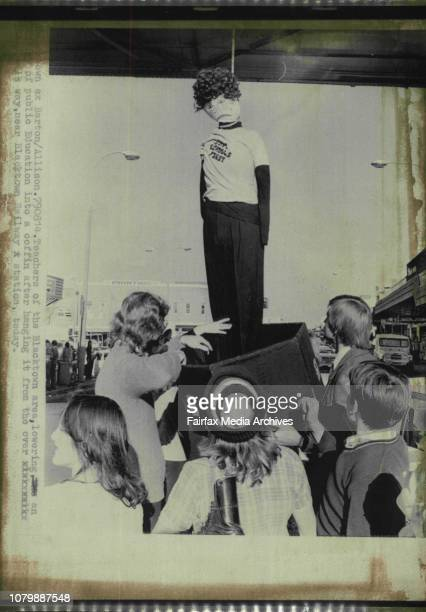 Teachers of the Blacktown area lowering an effigy of public Education into a coffin after hanging it from the over head walk way near Blacktown...