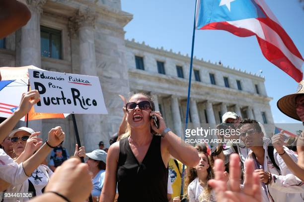 Teachers participate in a oneday strike against the government's privatization drive in public education in San Juan Puerto Rico on March 19 2018 /...