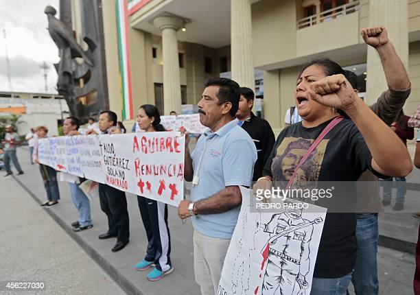 Teachers protest in demand of justice for the deaths of six people including students of Ayotzinapa and football players of the team Los Avispones in...