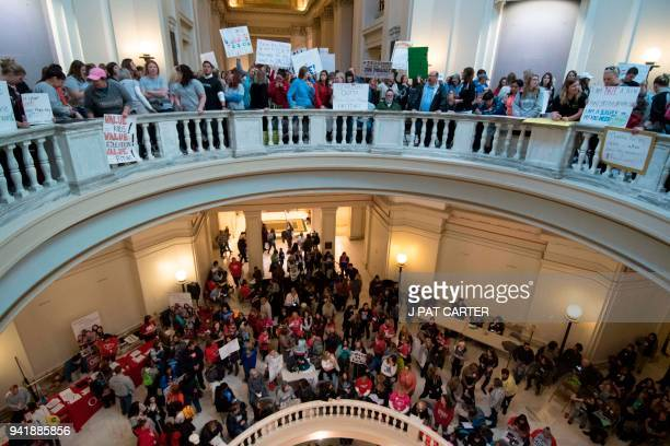 Teachers rally at the state capitol in Oklahoma City Oklahoma on April 4 2018 Thousands of teachers and supporters are scheduled to rally at the...