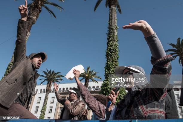 Teachers shout slogans during a protest on violence against teachers at the Bab alAhad Square in Rabat Morocco on December 03 2017 Hundreds of...