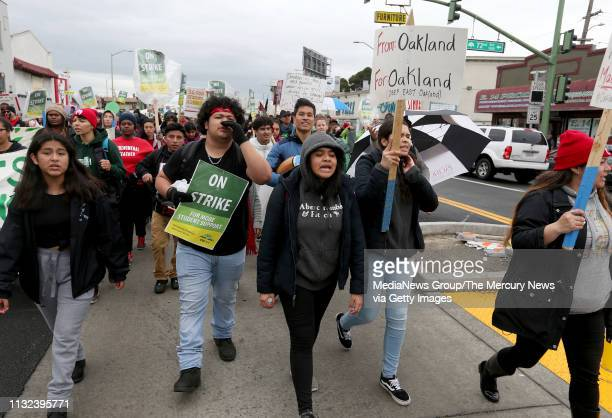 Teachers students and supporters march down International Boulevard towards a rally at Roots International Academy in Oakland Calif on Tuesday Feb 26...