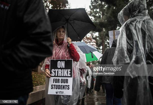 Teachers students friends and family protest and picket in the pouring rain outside John Marshall High School during a United Teachers Los Angeles...
