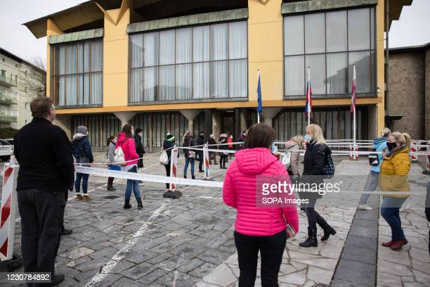 Teachers wait outside town hall to take a rapid COVID-19 antigen test before elementary schools reopen in Kranj. Elementary School teachers take mass...