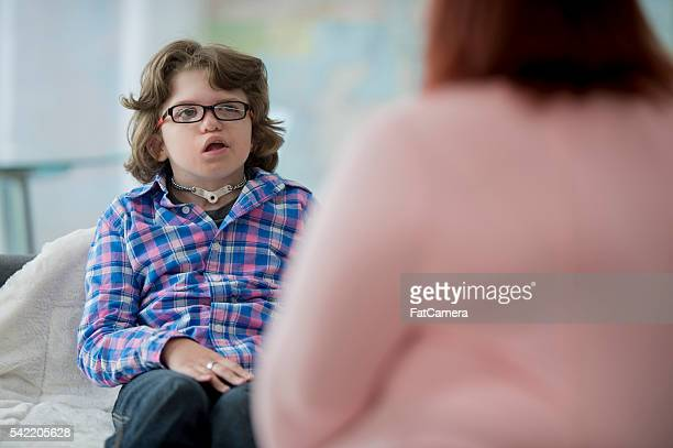 teaching a child sign language - assistive technology stock photos and pictures