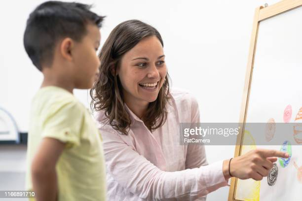 teaching about our soloar system - montessori education stock pictures, royalty-free photos & images