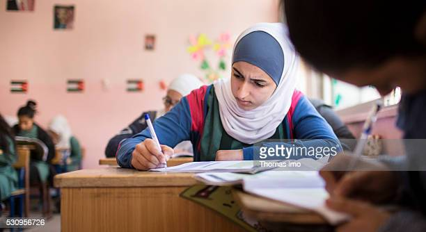 Teaching at the school bilayer Al Quds Amman There Jordanian and Syrian children are taught in separate layers on April 03 2016 in Amman Jordan