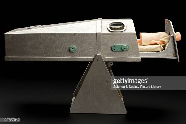 Teaching doll showing an iron lung. England, 1930-50. Wooden model of an iron lung, with plastic infant doll and bedding enclosed. Probably used to...