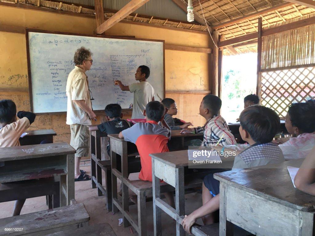 Teaching english in a rural Cambodian school : Stock Photo