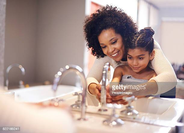 teaching her about good hygiene - washing hands stock pictures, royalty-free photos & images