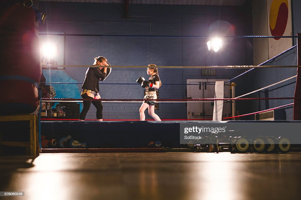 Teaching her to fight! : Stock Photo