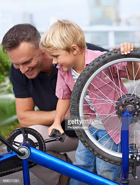 Teaching him about bike maintenance