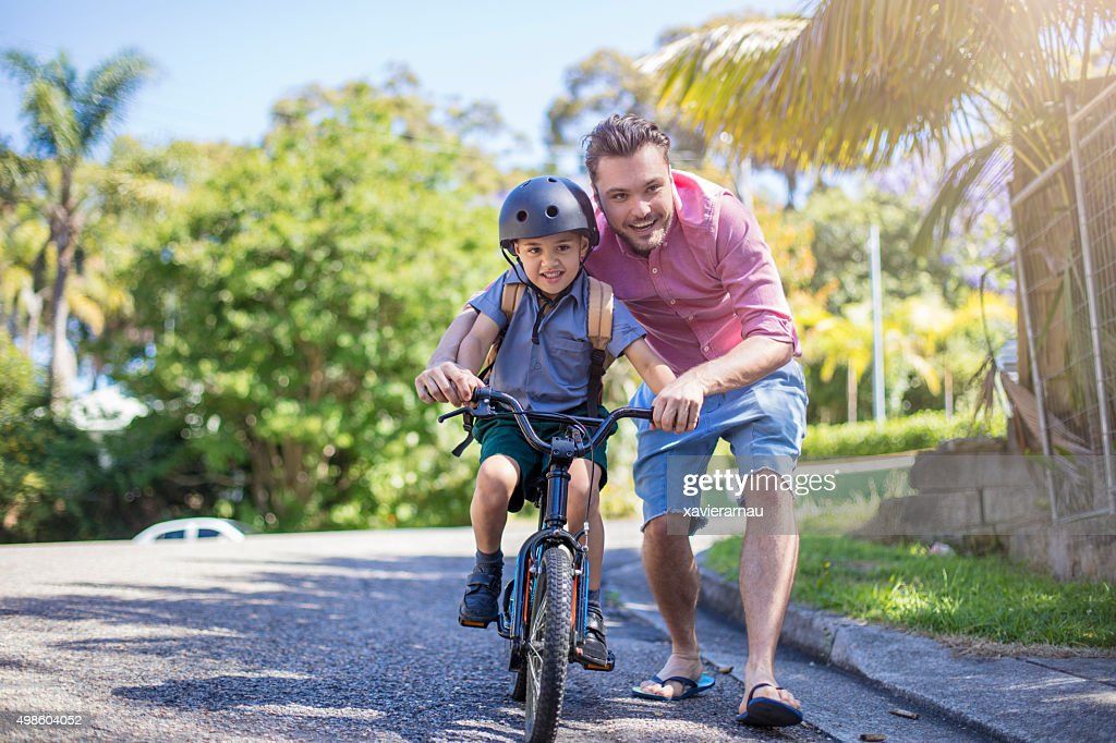 Teaching how to ride a bicycle : Stock Photo