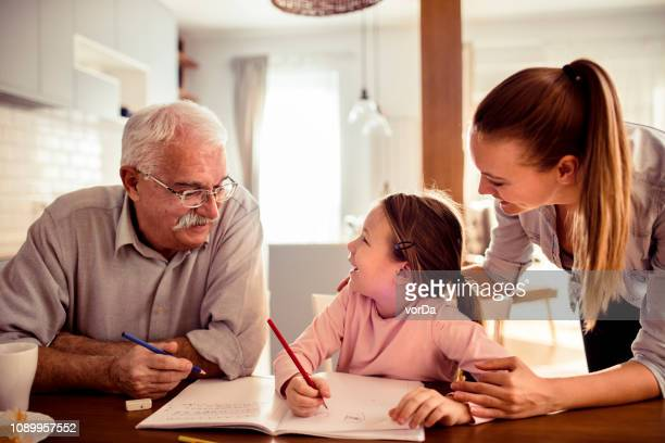 teaching - multigenerational family stock pictures, royalty-free photos & images