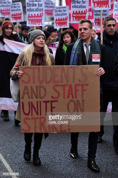 Teaching staff from the Universities and Colleges Employers Association and supporters take part in a protest rally over a pay dispute in central...