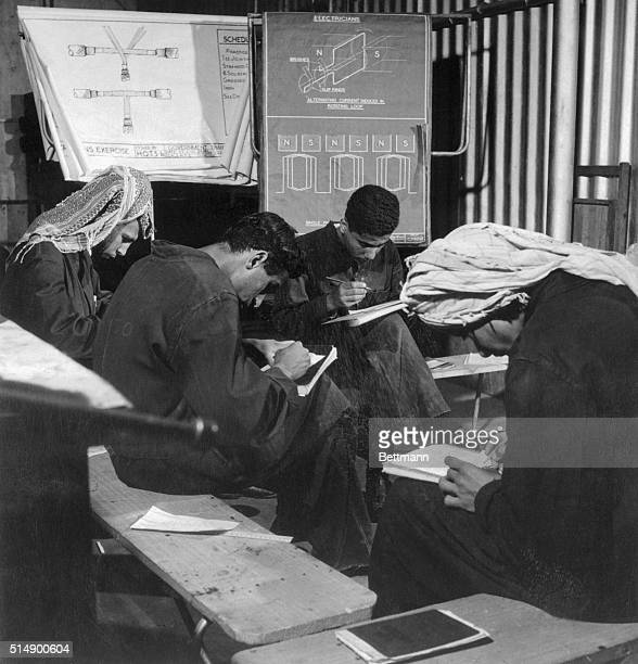 Teaching staff of Kuwait Oil Company's training school numbers 63, such as these young men who are studying the basic principles of electrical...