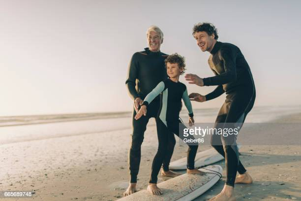 teaching surfing - modern manhood stock pictures, royalty-free photos & images