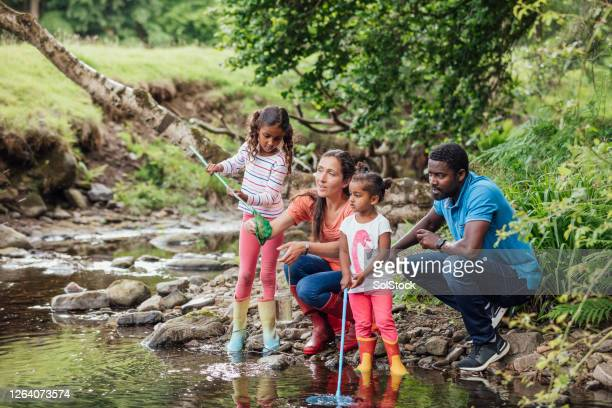 teaching the girls to fish - outdoor pursuit stock pictures, royalty-free photos & images