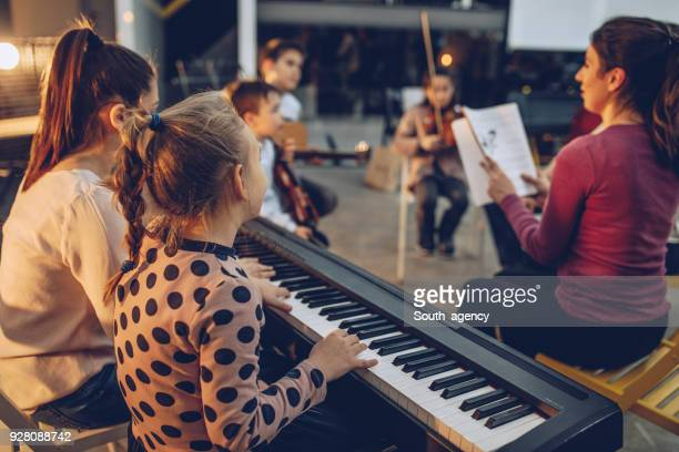 teaching to play music - keyboard instrument stock photos and pictures