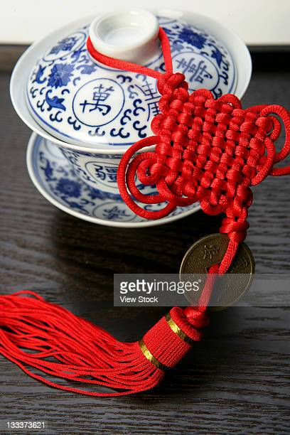 teacup and chinese knot - chinese knotting stock pictures, royalty-free photos & images