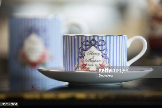 A teacup and saucer to commemorate the wedding between Henry Windsor and Meghan Markle stands on display at Halcyon Days Ltd's factory in...