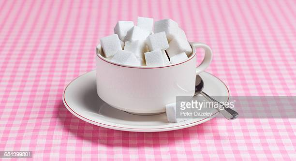 Teacup full of sugar lumps