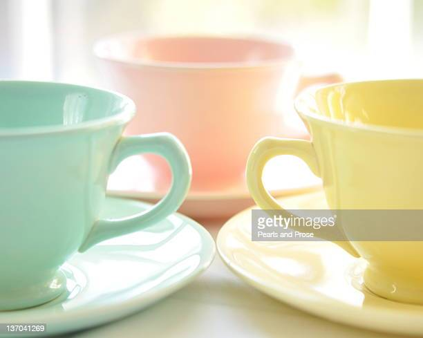 teacups and saucers - pastel stock pictures, royalty-free photos & images