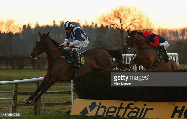 Teaforthree ridden by J.J Codd clears the last fence on their way to victory in the Bet On Your Mobile At Corbettsports Open Hunters' Steeple Chase...