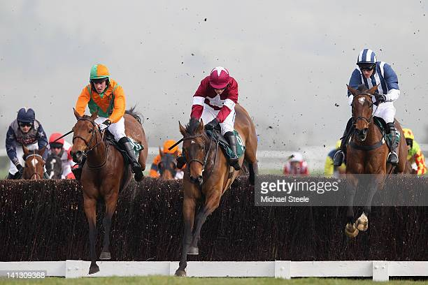 Teaforthree ridden by JT McNamara on his way to winning the Diamond Jubilee National Hunt steeple chase from Four Commanders ridden by Nina Carberry...