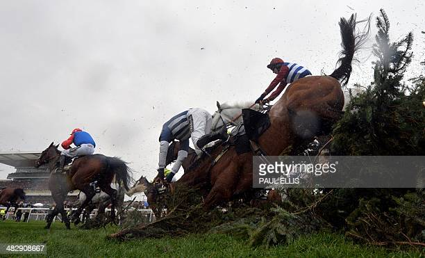 Teaforthree ridden by Nick Scholfield is unseated at The Chair during the Grand National horse race at Aintree Racecourse in Liverpool, north-west...