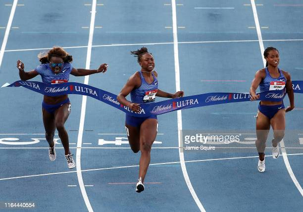 Teahna Daniels crosses the finish line first to win the Women's 100 Meter Final during the 2019 USATF Outdoor Championships at Drake Stadium on July...