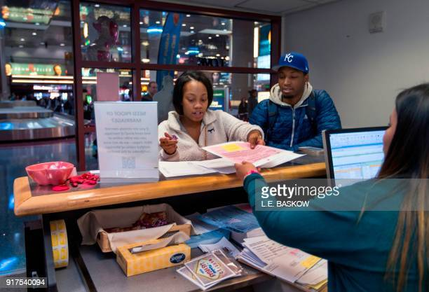 Teaira Thompson and James Anderson of Burlington Iowa complete their paperwork as the Clark County Clerk's Office operates a temporary popup marriage...