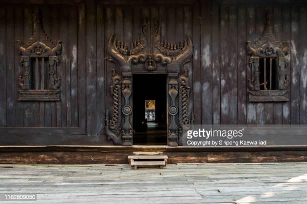 teak carving door and windows at bagaya kyaung, mandalay, myanmar. - teak wood material stock pictures, royalty-free photos & images