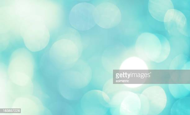 Teal and white abstract defocused light background