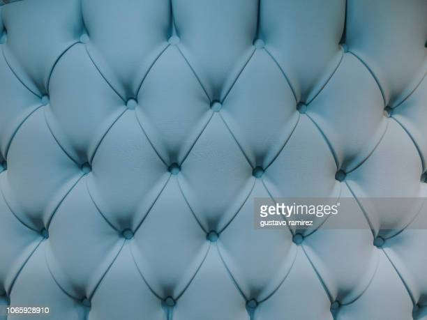 teal blue capitone textile background - terciopelo fotografías e imágenes de stock