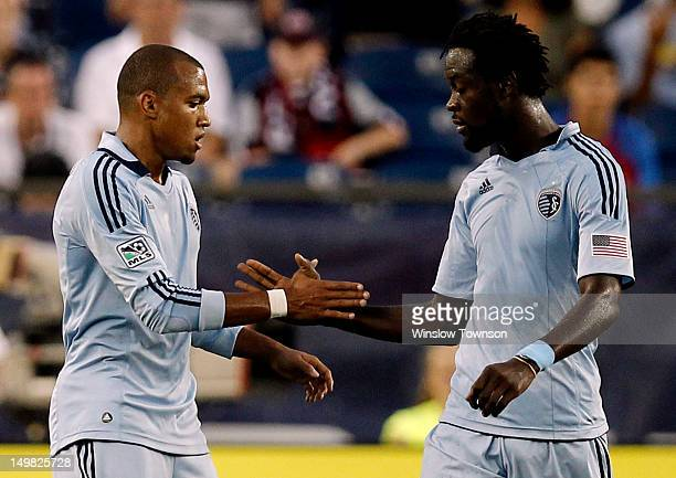 Teal Bunbury is congratulated by Kei Kamara of Sporting KC after scoring against the New England Revolution during the first half at Gillette Stadium...