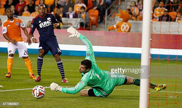 Teal Bunbury of New England Revolution has his shot go just wide of a diving Tally Hall of the Houston Dynamo at BBVA Compass Stadium on March 8 2014...