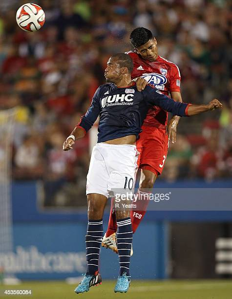 Teal Bunbury of New England Revolution heads the ball in front of Moises Hernandez of FC Dallas at Toyota Stadium on July 19 2014 in Frisco Texas