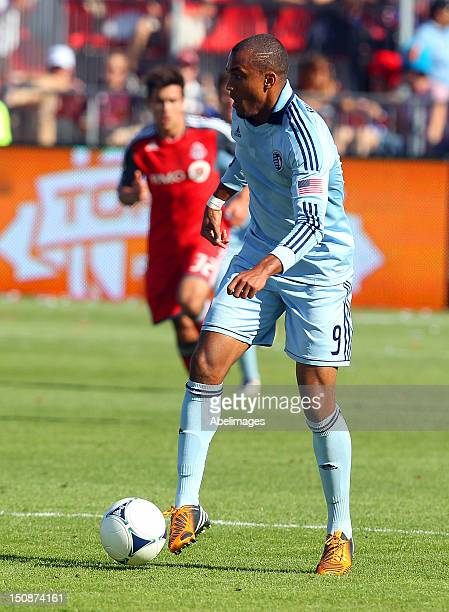 Teal Bunbury of Sporting Kansas City carries the ball against the Toronto FC during MLS action at BMO Field August 18 2012 in Toronto Ontario Canada