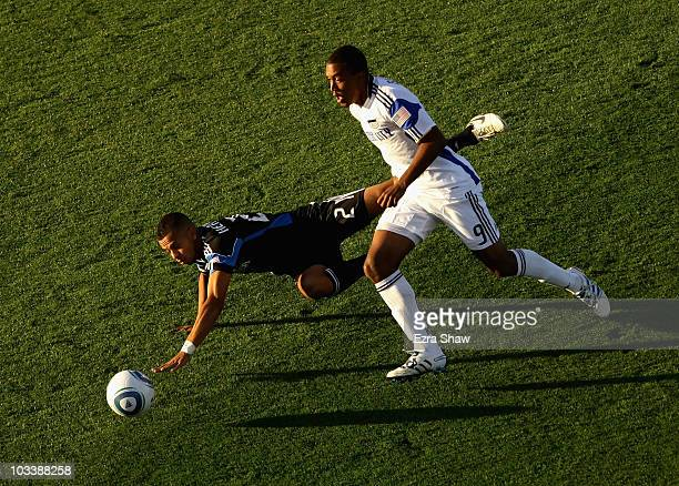 Teal Bunbury of the Kansas City Wizards and Jason Hernandez of the San Jose Earthquakes go for the ball at Buck Shaw Stadium on August 14 2010 in...