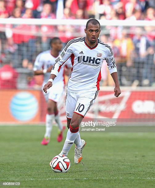 Teal Bunbury of the New England Revolution advances the ball against the Chicago Fire at Toyota Park on April19 2014 in Bridgeview Illinois The Fire...