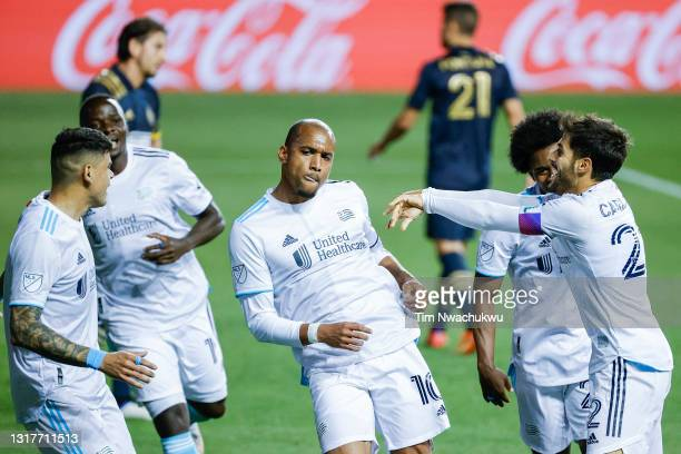 Teal Bunbury of the New England Revolution celebrates a goal with teammates during the second half against the the Philadelphia Union at Subaru Park...
