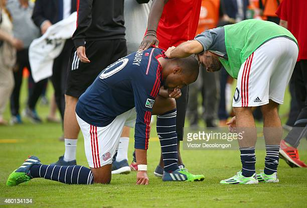 Teal Bunbury of the New England Revolution is consoled by teammate Kevin Alston after losing to the Los Angeles Galaxy 21 in the 2014 MLS Cup at...