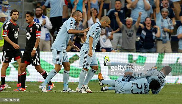 Teal Bunbury of the Sporting Kansas City celebrates his goal with Kei Kamara during a game against the DC United in the first half at Livestrong...