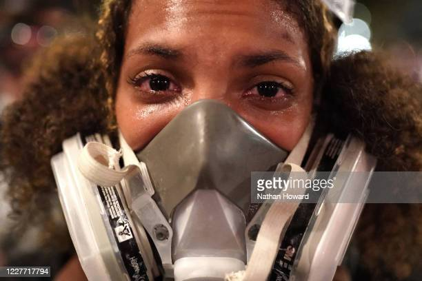 Teal Lindseth reacts to tear gas after federal officers dispersed protesters from in front of the Mark O. Hatfield U.S. Courthouse on July 20, 2020...