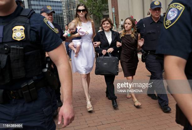 Teala Davies, one of deceased financier Jeffrey Epstein's alleged victims, attorney Gloria Allred, and another unidentified alleged victim and her...