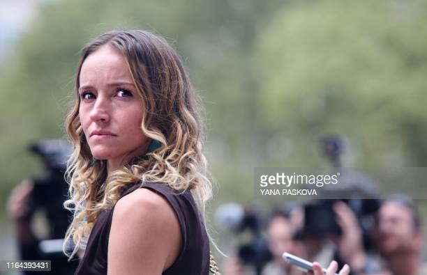 Teala Davies, one of deceased financier Jeffrey Epstein's alleged victims, listens to discrimination attorney Gloria Allred talk to the press outside...