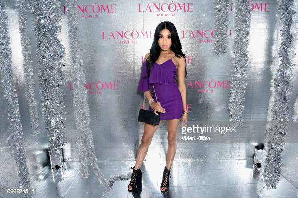 Teala Dunn attends Lancôme x Vogue Holiday Event at Delilah West Hollywood on November 29 2018 in West Hollywood California