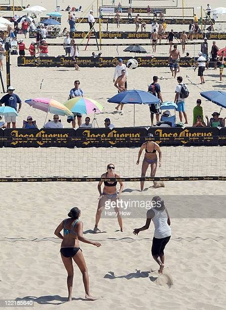 Tealle Hankus and Heather Lowe wait for a ball in a match against Annett Davis and Jenny Johnson Jordan during the Manhattan Beach Open at Manhattan...