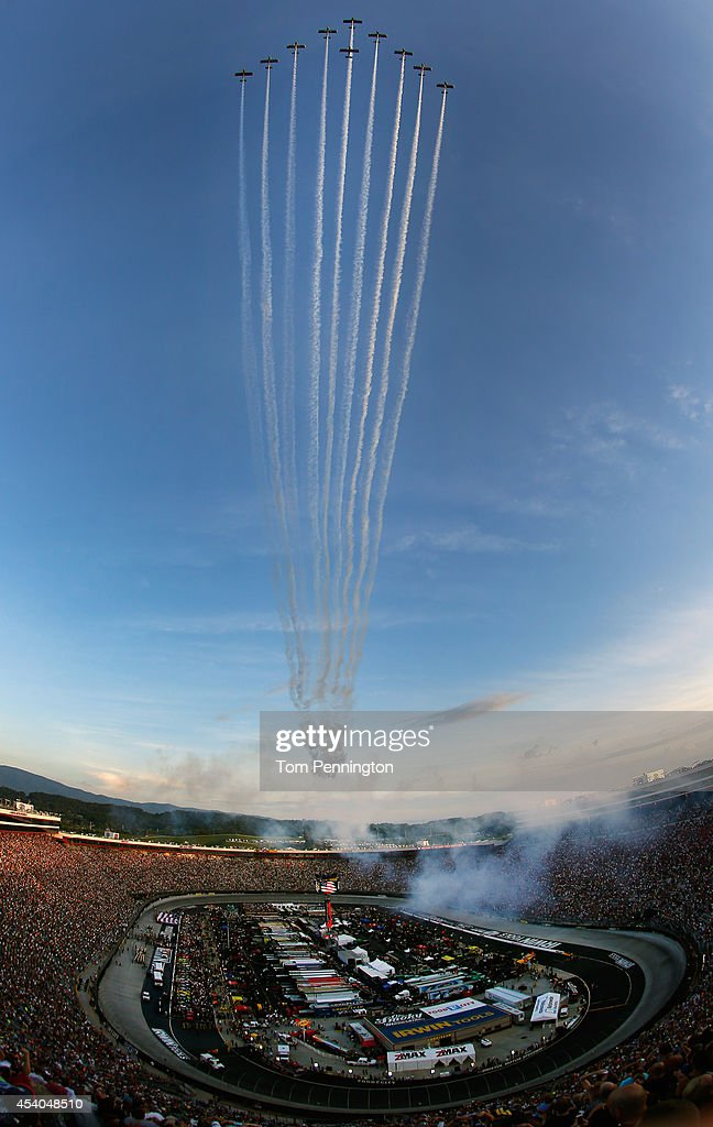 Team Aerodynamix performs a flyover before the start of the NASCAR Sprint Cup Series Irwin Tools Night Race at Bristol Motor Speedway on August 23, 2014 in Bristol, Tennessee.